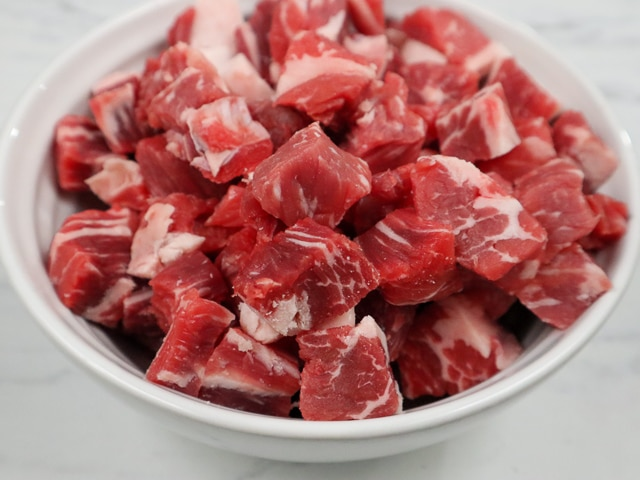 bowl of rib-eye steak cut into cubes
