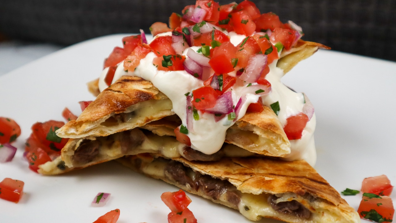 image of a pile of grilled steak quesadilla