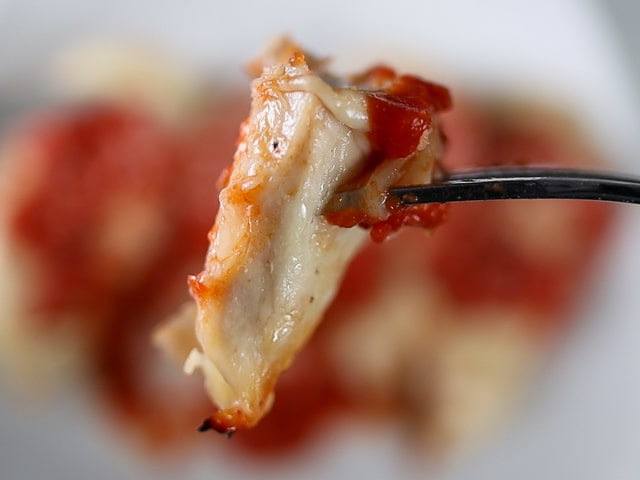 Bite of grilled chicken parmesan