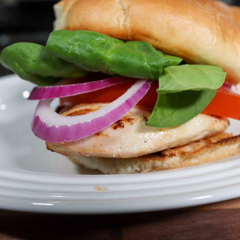 healthy grilled chicken sandwich sitting on a plate