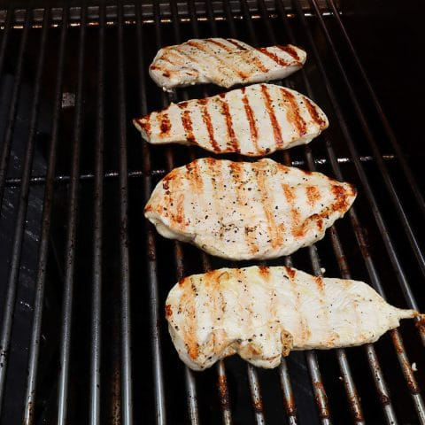 chicken breast being grilled
